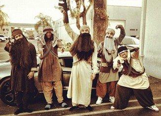 Chris Brown dressed as gun toting Taliban terrorist at Halloween party
