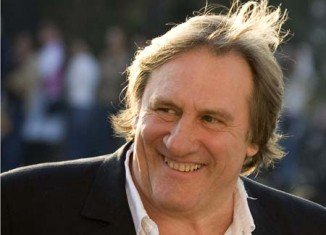 Gerard Depardieu emerged from a police station in Paris on Friday morning, where he was held overnight after getting arrested for driving the scooter while drunk