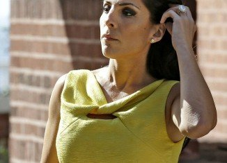Jill Kelley, Florida socialite at the centre of the David Petraeus sex scandal, has spoken for the first time and said she is an innocent victim