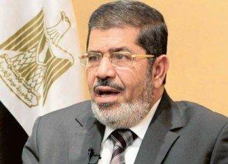 Mohammed Mursi has appeared before supporters in Cairo to defend a new decree that grants him sweeping powers