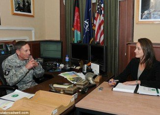 Paula Broadwell allegedly sent threatening e-mails to another woman she suspected of being too close to David Petraeus