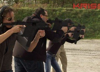 Paula Broadwell is featured in an advertisement for Kriss Arms, where she leans on years of military research and her shooting savvy to praise the design of the guns