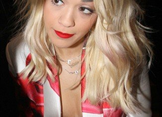 Rita Ora met fans outside the Charles Hotel in Munich on Thursday and her bra was left exposed throughout the meeting