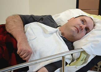Scott Routley, a Canadian man who was believed to have been in a vegetative state for more than a decade, has been able to tell scientists that he is not in any pain