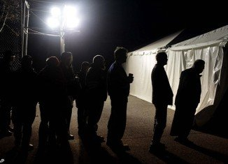 Staten Island residents were guided to a polling site in the dark this morning by flares as problems mounted for New York voters across the city struggling with power outages caused by Hurricane Sandy