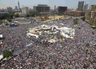 Tens of thousands of people are holding a protest in Cairo against President Mohamed Morsi, who last week granted himself sweeping new powers in Egypt
