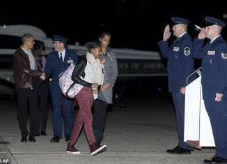 Barack, Michelle, Malia and Sasha Obama headed to Hawaii for Christmas, shortly after the president had delivered a statement on extended the last Bush administration's tax cuts