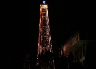 Church groups in South Korea have illuminated a giant Christmas tree-shaped tower near the border with North Korea for the first time in two years
