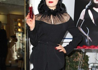 Dita Von Teese arrived late at her new fragrance Rouge launch event at Fred Segal