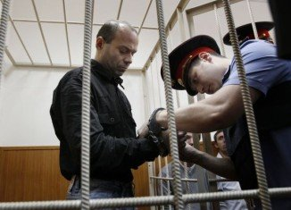 Dmitry Pavlyuchenkov, a former Russian police officer, has been jailed for 11 years for his role in the murder of prominent journalist Anna Politkovskaya