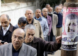 Egypt begins voting in a second stage of a constitutional referendum that has sparked weeks of unrest in the country's main cities