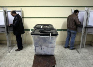 Egyptians are awaiting the official results of a referendum on a controversial draft constitution