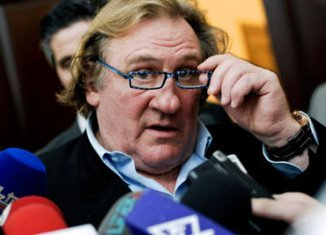 French Prime Minister Jean-Marc Ayrault suggested that Gerard Depardieu's move to Belgium, just over the border from the French city of Lille, was unpatriotic at a time of cutbacks