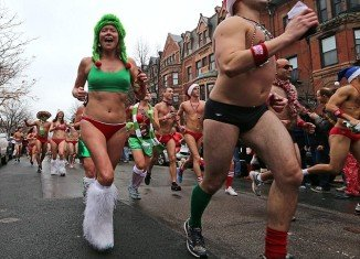 Joggers took to the streets wearing almost nothing as they raced through Boston to raise money for children's charities at the 13th annual Speedo Santa Run