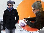 Macaulay Culkin proved that he was doing just fine as he hit the shops to get the last of his Christmas gifts on Saturday, despite starting the day by eating alone at Taco Bell
