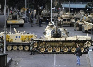 The Egyptian army has deployed tanks and armored troop carriers outside the presidential palace in Cairo after clashes between supporters and rivals of President Mohammed Morsi