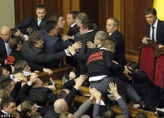 Ukrainian parliament's new session got off to a dramatic start with MPs brawling on the floor of the chamber