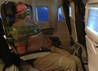 A drunken passenger on an IcelandAir flight from Iceland to New York was duct-taped to his seat by fellow passengers after attacking one woman and screaming the plane was going to crash
