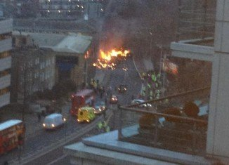 A helicopter has crashed into a crane at a building site in south London