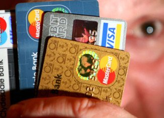 A new credit card rule going into effect Sunday, January 27, 2013, could cost you more when shopping with a credit card at some stores