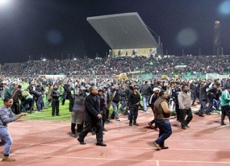 An Egyptian court has sentenced to death 21 defendants over clashes between rival football fans at Port Said stadium in which 74 people were killed last February
