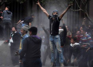 Egyptian police have clashed with protesters gathering in Tahrir Square in capital Cairo ahead of the second anniversary of the uprising that swept Hosni Mubarak from power