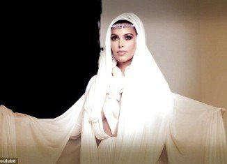 Kim Kardashian swapped her usual fashion for a series of veils as she took part in a cover shoot for Arabian luxury women's magazine, Hia