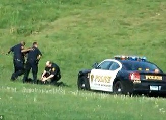 Three Connecticut police officers have been put on administrative leave after they were caught on video brutally beating a suspect in a local park