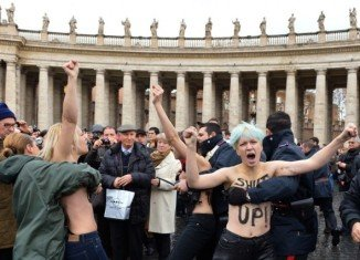 Three activists of the Ukrainian women's rights movement Femen staged a protest at the Vatican on Sunday, shortly after the Pope's regular Sunday address