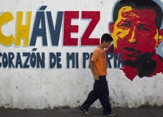 Venezuela's National Assembly has approved a request by President Hugo Chavez to postpone his inauguration for a new term in office