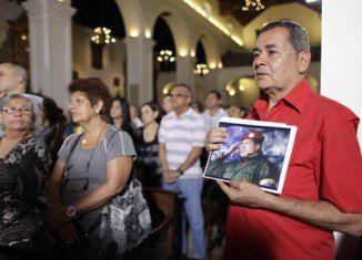 Venezuela's cabinet ministers got together to pray for the recovery of President Hugo Chavez, who is in Cuba recovering from cancer operation