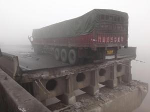 A truck carrying fireworks has exploded on an elevated highway in Henan province, central China, killing at least five people and causing part of the road to collapse