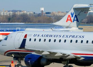 American Airlines and US Airways are to announce their official merge to become the world's biggest airline after the boards of both companies approved the deal late Wednesday