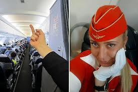 Flight attendant Tatiana Kozlenko, who posted a picture of herself giving her passengers the finger, has been sacked by Aeroflot airline