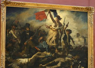 French police have detained a woman accused of defacing iconic Delacroix painting Liberty Leading The People at a branch of the Louvre Museum