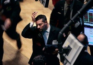 Global stock markets have fallen after some members of the Federal Reserve suggested its stimulus measures may be increasing the risks of future economic and financial imbalances
