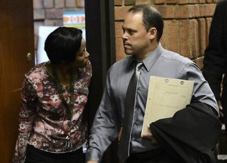 Hilton Botha, the South African detective leading the Oscar Pistorius inquiry, is facing seven charges of attempted murder