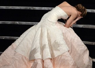 Jennifer Lawrence was left flustered after tripping up the steps on her way to accept her Oscar for Best Actress