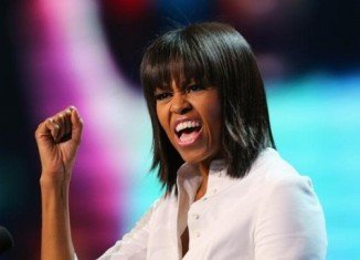 Michelle Obama jokingly says a mid-life crisis is what inspired her new haircut with bangs