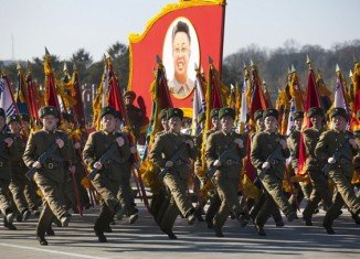 """North Korea has commemorated late leader Kim Jong-il's 70th birthday with a military parade, pledges of loyalty to his son, Kim Jong-un, and thousands of red """"kimjongilia"""" begonias"""