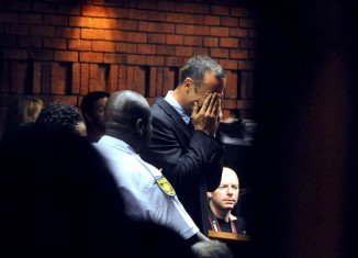 Oscar Pistorius carried his dying girlfriend Reeva Steenkamp downstairs and tried to resuscitate her as he desperately attempted to save her life