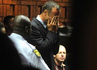 Oscar Pistorius has strongly rejected a charge that he murdered his girlfriend, Reeva Steenkamp