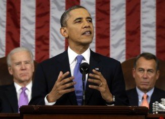 President Barack Obama has urged US Congress to back government action to revive the country's sluggish economy, in his annual State of the Union speech