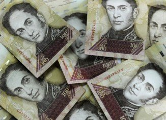 Venezuela has cut the value of its currency against the US dollar by 32 percent, in an effort to boost the country's economy