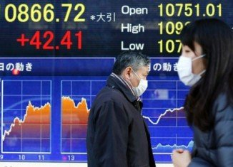 Asian stock markets have continued a global rally after New York's main Dow Jones share index hit a historical record high