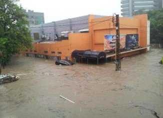 At least 11 people have died after sudden rains caused flooding in the Mauritian capital Port Louis on Saturday