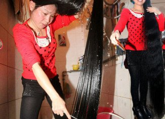 Cen Yingyuan from China hasn't cut her hair for the past 11 years and her locks now hang at 6 ft 7 in long