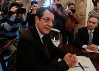 Cypriot President Nicos Anastasiades is locked in bailout talks with EU, European Central Bank and IMF leaders in Brussels