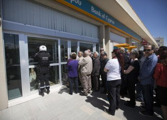 Cypriot banks opened on Thursday, March 28, for the first time in nearly two weeks amid severe new rules imposed as part of the bailout deal