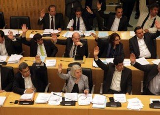 Cyprus parliament has voted to restructure the island's banks